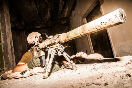 sniper: Navy Seal Sniper with rifle in action Stock Photo
