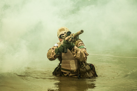 seal: Member of Navy SEAL Team crossing the river with weapons