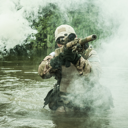 sof: Member of Navy SEAL Team crossing the river with weapons