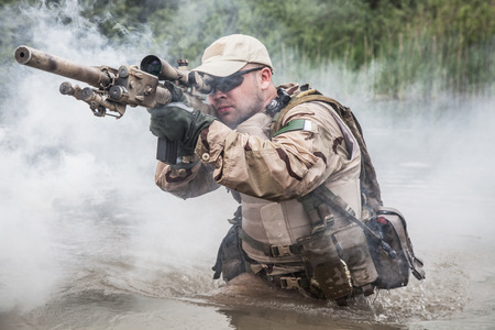 military forces: Member of Navy SEAL Team crossing the river with weapons