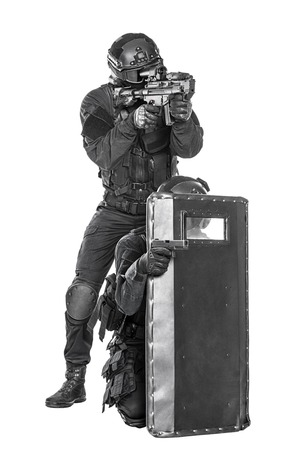 anti nato: Spec ops police officer SWAT with ballistic shield studio shot