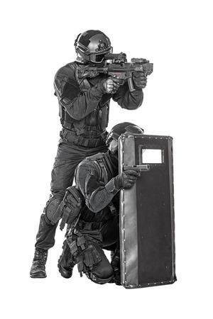 spec: Spec ops police officer SWAT with ballistic shield studio shot