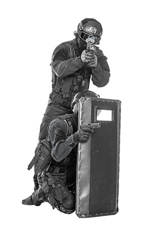 police officer: Spec ops police officer SWAT with ballistic shield studio shot
