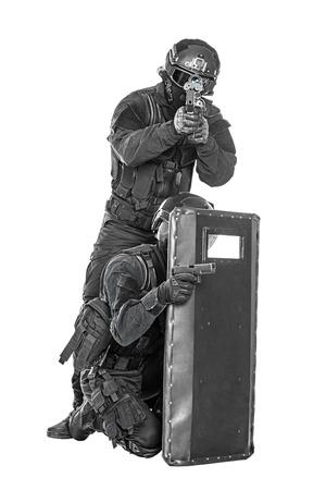 swat: Spec ops police officer SWAT with ballistic shield studio shot