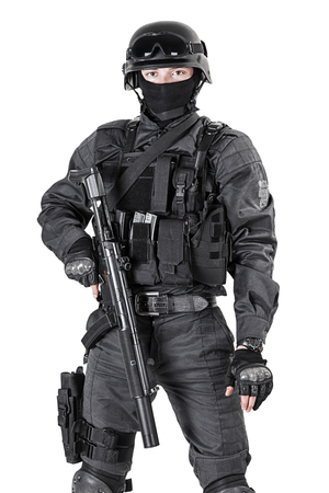 Spec ops police officer SWAT in black uniform studio shot Foto de archivo