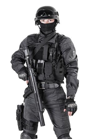 Spec ops police officer SWAT in black uniform studio shot Stockfoto