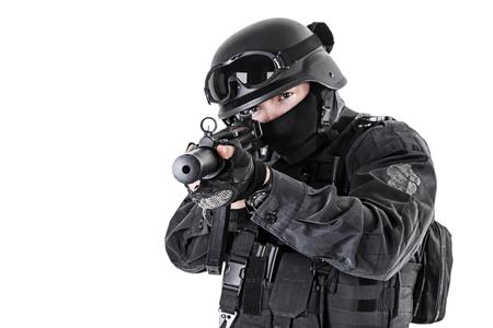 counter terrorism: Spec ops police officer SWAT in black uniform studio shot Stock Photo