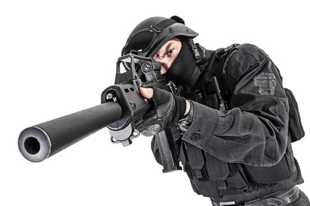 spec: Spec ops police officer SWAT in black uniform studio shot Stock Photo