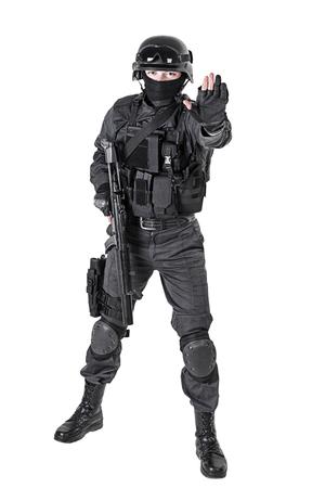 anti nato: Spec ops police officer SWAT in black uniform studio shot Stock Photo