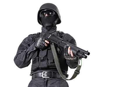 anti nato: Spec ops police officer SWAT in black uniform with shotgun studio shot