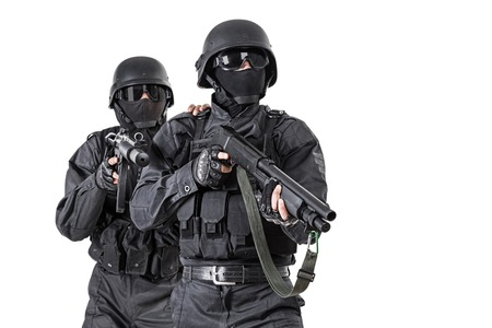 ops: Spec ops officers SWAT in black uniform in action