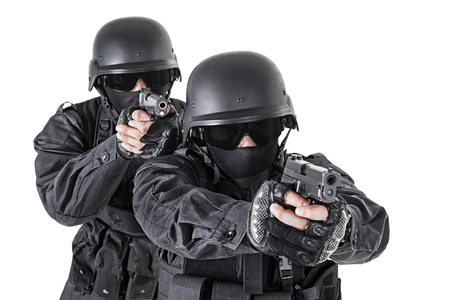 anti nato: Spec ops officers SWAT in black uniform in action