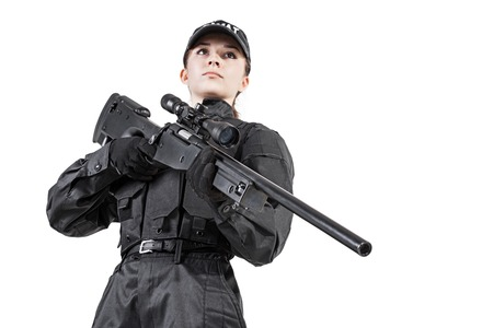 female police: Female police officer SWAT in black uniform with sniper rifle studio shot