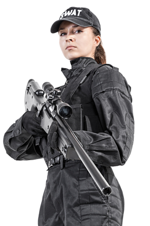 Female police officer SWAT in black uniform with sniper rifle studio shot
