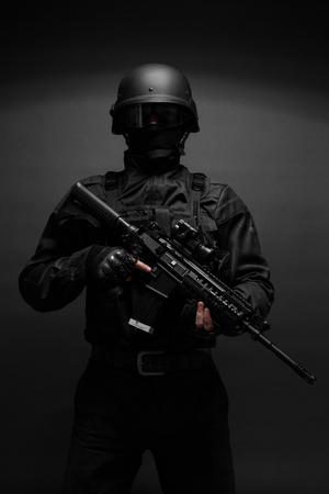 Spec ops police officer SWAT in black uniform studio Stok Fotoğraf - 47309247