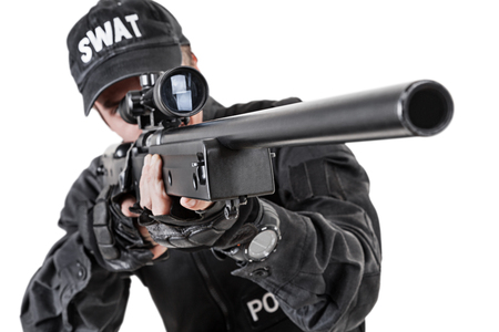swat: Spec ops police officer SWAT in black uniform studio