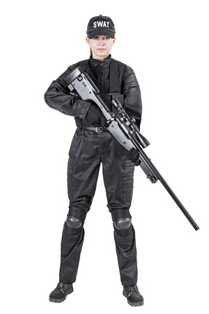 Female police officer SWAT in black uniform with sniper rifle studio shot