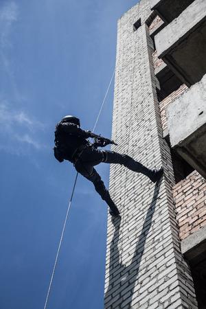assault: Spec ops police officer SWAT during assault operation