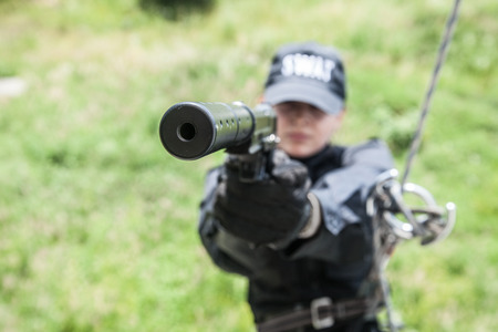 female police: Female police officer SWAT during assault operation