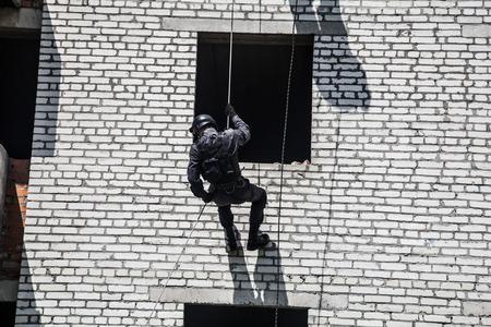 rappelling: Spec ops police officer SWAT during assault operation