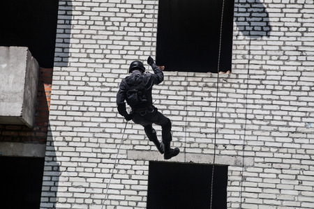 counter terrorism: Spec ops police officer SWAT during assault operation