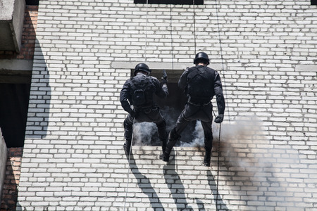 anti nato: Spec ops police officer SWAT during assault operation
