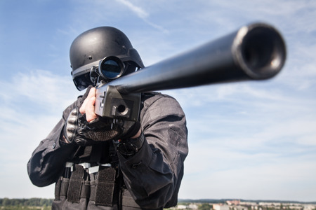 police: SWAT police sniper in black uniform in action Stock Photo
