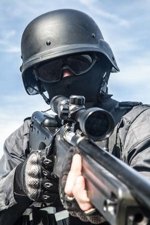 anti nato: SWAT police sniper in black uniform in action Stock Photo