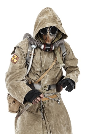 post apocalypse: Nuclear post apocalypse. Studio shot of survivor in tatters and gas mask Stock Photo