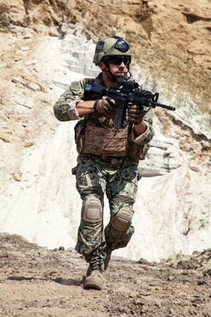 sof: Member of Navy SEAL Team with weapons in action Stock Photo