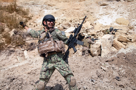 sof: Members of Navy SEAL Team with weapons in action Stock Photo