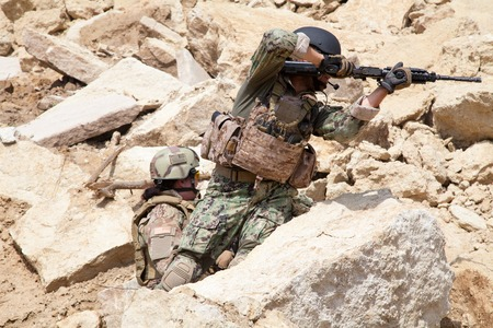 navy seal: Members of Navy SEAL Team with weapons in action Stock Photo