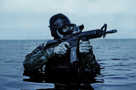 sof: Navy SEAL frogman with complete diving gear and weapons in the water