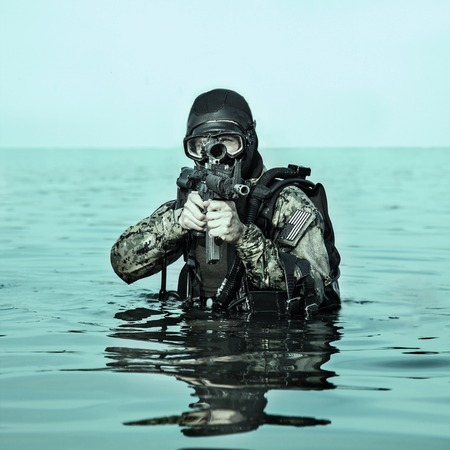 navy seal: Navy SEAL frogman with complete diving gear and weapons in the water