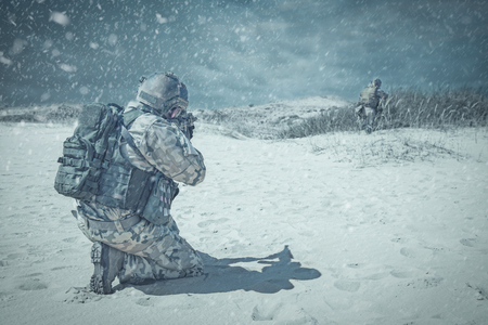 militant: Two soldiers in actiorn through the snowstorm