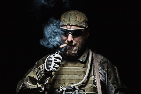 berets: Green Berets US Army Special Forces Group soldier smoking