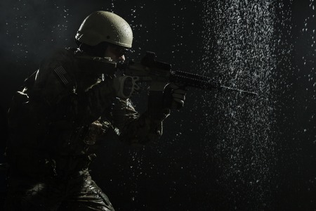 special operations: Green Berets US Army Special Forces Group soldier in the rain