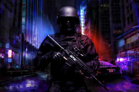 assault rifle: Spec ops police officer SWAT in black uniform on the street