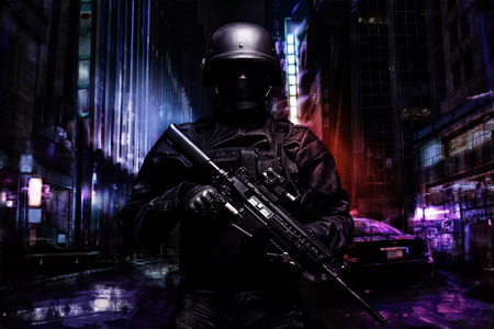 Spec ops police officer SWAT in black uniform on the street