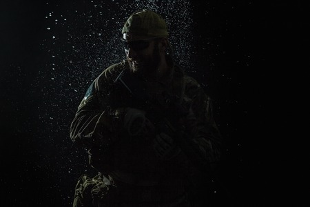 berets: Green Berets US Army Special Forces Group soldier in the rain