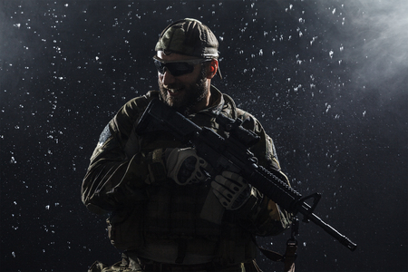 recon: Green Berets US Army Special Forces Group soldier in the rain