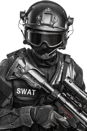 swat: Spec ops police officer SWAT in black uniform and face mask studio shot