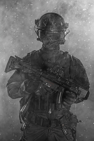 counter terrorism: Police officer SWAT in black uniform in the smoke