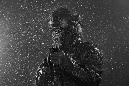 rain wet: Spec ops police officer SWAT in the rain Stock Photo