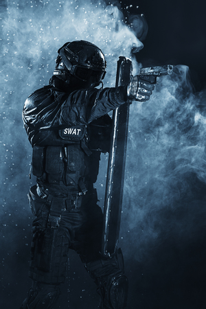 ballistic: Spec ops police officer SWAT with ballistic shield Stock Photo