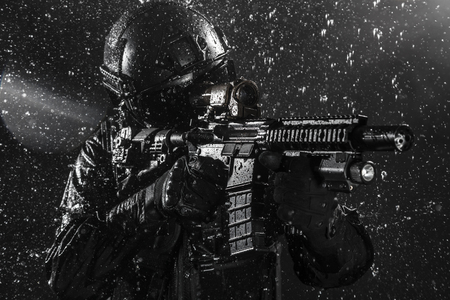 spec: Spec ops police officer SWAT in the rain Stock Photo