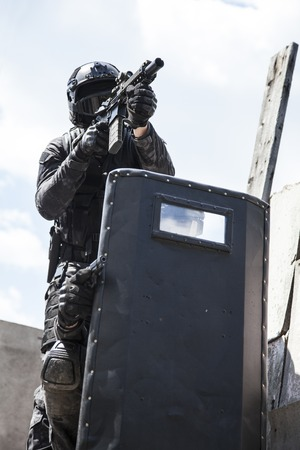 counter terrorism: Spec ops police officers SWAT in black uniform in action