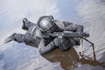 anti terrorist: Spec ops police officer SWAT in action in the water