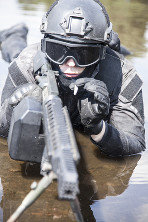 spec: Spec ops police officer SWAT in action in the water