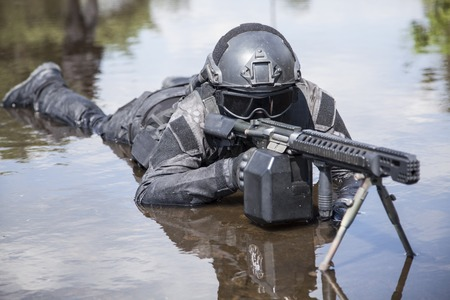 gi: Spec ops police officer SWAT in action in the water